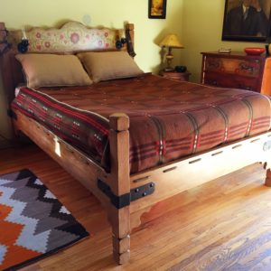 1930s Monterey Style bedframe custom painted by D Ward Designs to emulate the dresser in the background.